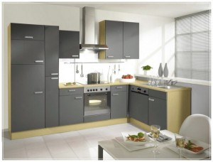 Grey-Kitchen-Cabinets-kitchen-decor-that-has-a-table-full-of-food.-glasses-filled-with-beverages-600x455