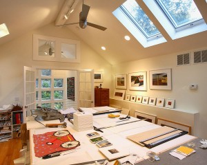 Home-office-with-extra-large-work-bench-for-artist-and-skylights